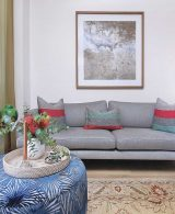 Upholstered sofa in pewter with ottoman