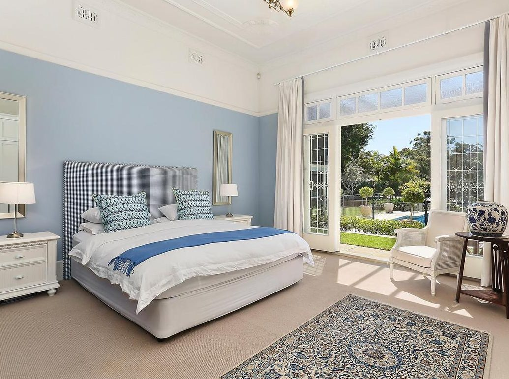 kIng size master bedroom in blue tones