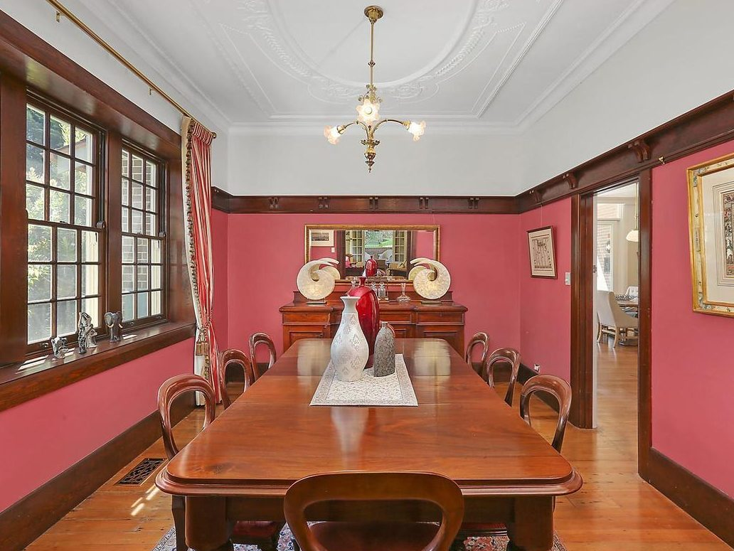 Formal dining room in red and cedar architectural elements