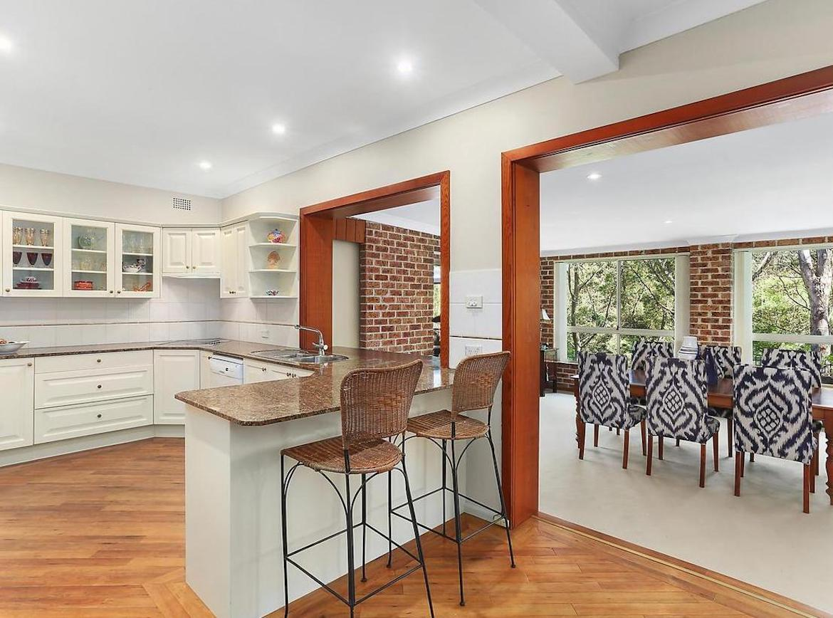 Open kitchen and dining space with ikat patterns upholstered chairs