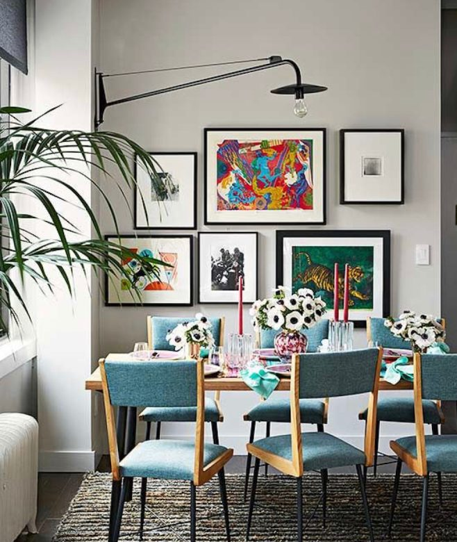 Dining space with framed artworks on wall