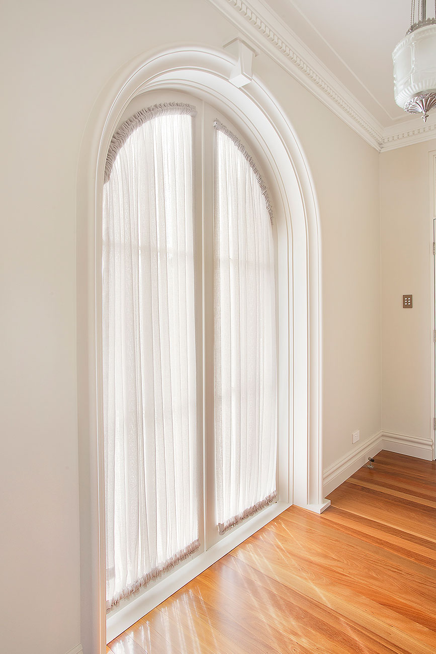 Sheer gathered curtain for arched french door