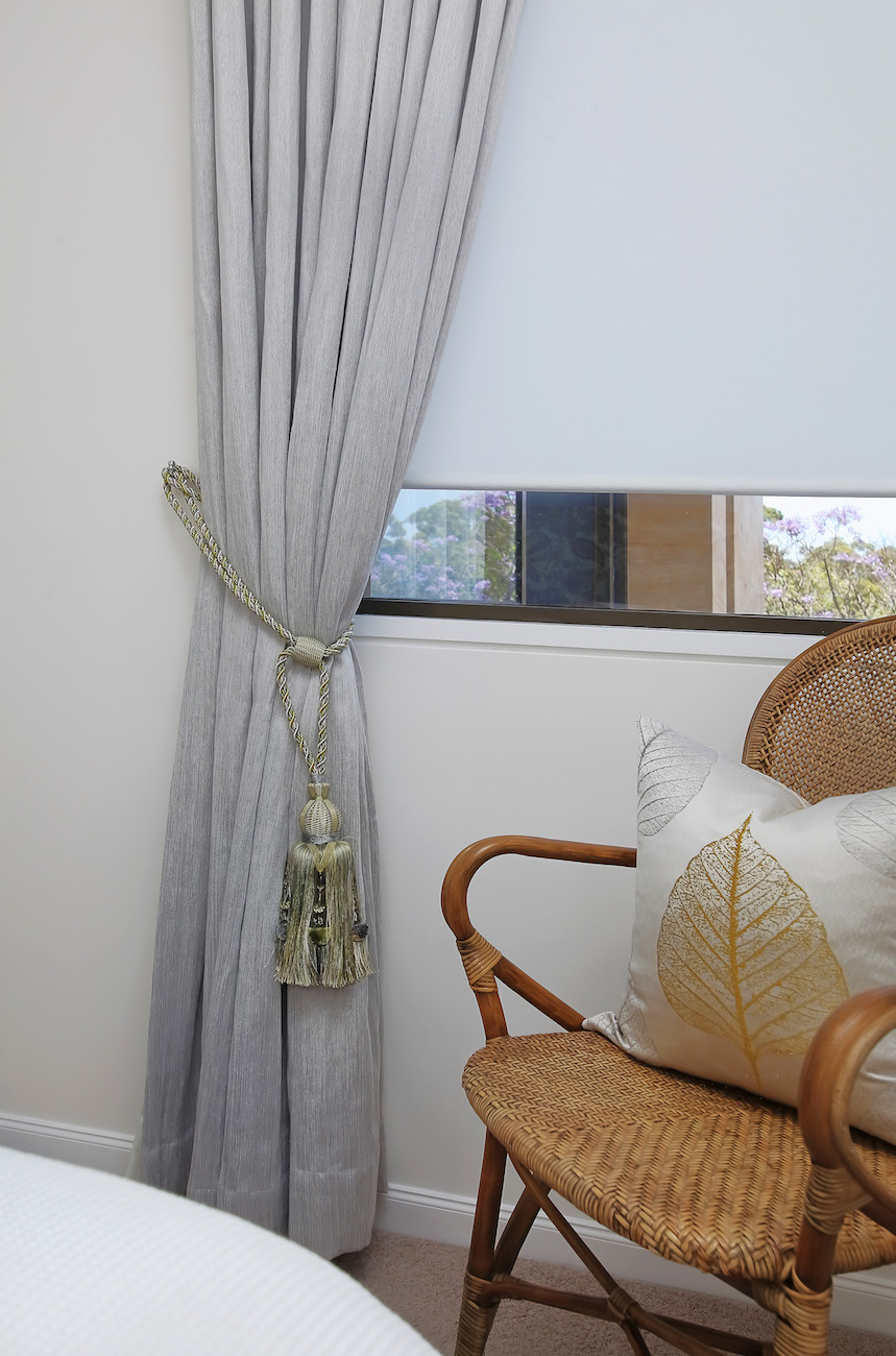 Curtain with tassel and blind