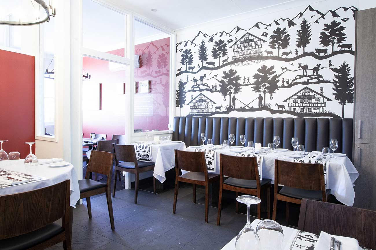 Banquette seating dining and Swiss design mural